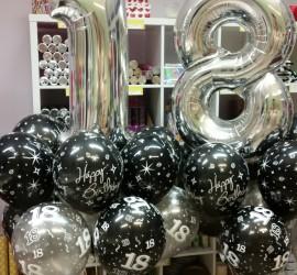 Folienzahlen 1 und 8 und Happy Birthday Luftballons in schwarz und silber