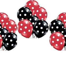 rot und schwarzer Latexballon mit weißen Punkten