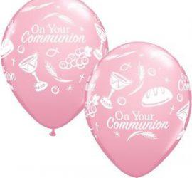 Rosafarbener Latexballon für die Erstkommunion